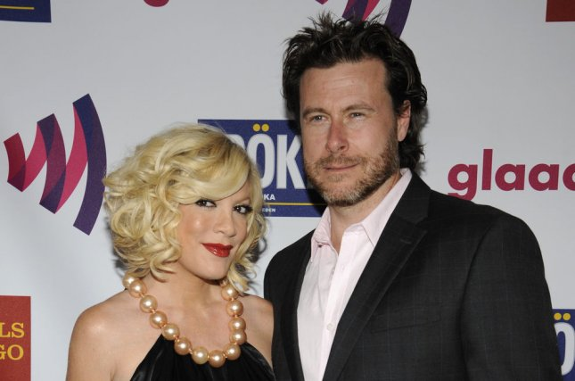 Tori Spelling (L) and Dean McDermott (R) celebrated their ninth wedding anniversary Thursday, May 7. Photo by Phil McCarten/UPI
