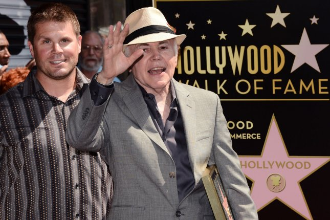 Actor Walter Koenig holds a replica plaque as he poses with Rod Roddenberry (L) during an unveiling ceremony honoring him with the 2,479th star on the Hollywood Walk of Fame in Los Angeles in 2012. File Photo by Jim Ruymen/UPI
