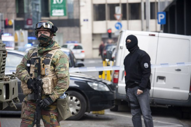 The U.S. Department of State revealed two more Americans were killed in Tuesday's Brussels bombings, bringing the total U.S. death toll to four. The Belgian capital has increased its security presence following the attacks and police have conducted dozens of raids. Photo by Diego Ravier/UPI