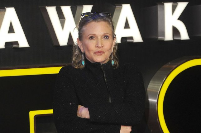 "Carrie Fisher attends the European premiere of ""Star Wars - The Force Awakens"" at Empire Leicester Square in London on December 16, 2015. Fisher revealed that she had an affair with Harrison Ford. File Photo by Paul Treadway/ UPI"