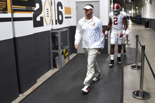 Former Alabama Crimson Tide offensive coordinator Lane Kiffin and running back Derrick Henry head to the field prior to game against the Clemson Tigers of the 2016 College Football Playoff National Championship at University of Phoenix Stadium in Glendale, Arizona on January 11, 2016. Photo by Jon SooHoo/UPI