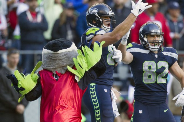 Seattle Seahawks tight end Jimmy Graham (88) celebrates with Seahawks tight end Luke Willson (82) after catching the game-winning, come-from-behind touchdown pass with 21 seconds remaining in the fourth quarter against the Houston Texans on Sunday at CenturyLink Field in Seattle, Wash. Photo by Jim Bryant/UPI