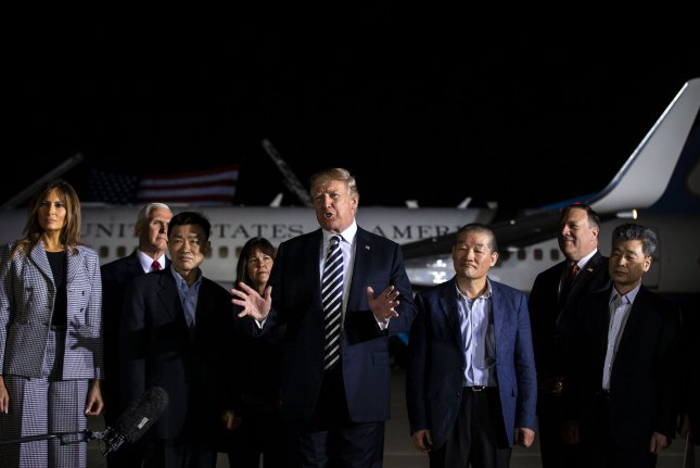 President Donald Trump speaks at Andrews Air Force Base, Maryland, early Thursday after the return of formerly detained U.S. citizens Kim Hak-Song, Kim Dong-Chul, and Kim Sang-Duk. Photo by Al Drago/UPI