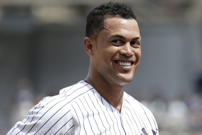 New York Yankees outfielder Giancarlo Stanton smiles while he stands on third base in the 5th inning against the Kansas City Royals on July 29 at Yankee Stadium in New York City. Photo by John Angelillo/UPI