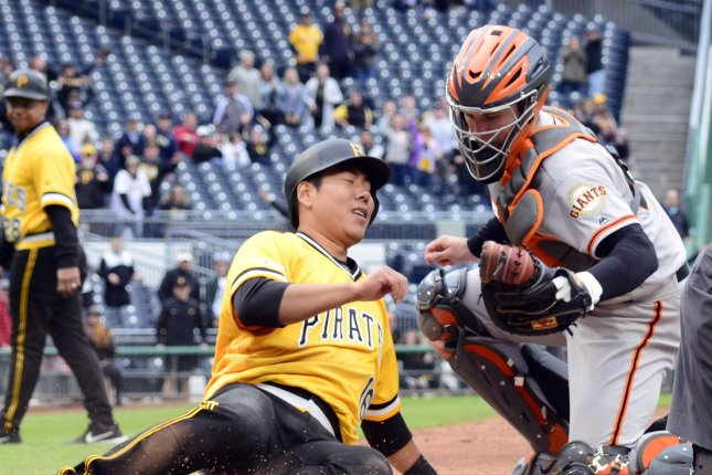 San Francisco Giants catcher Buster Posey tags Pittsburgh Pirates shortstop Jung Ho Kang out at home earlier this season. Posey was placed on the seven-day concussion list Thursday. File Photo by Archie Carpenter/UPI