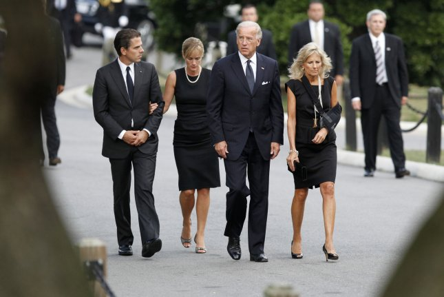 Then-U.S. Vice President Joe Biden arrives at Arlington National Cemetery in Arlington, Va., with wife Jill Biden, his son Hunter (L) and his wife Kathleen in 2009. File Photo by Jim Bourg/UPI/Pool