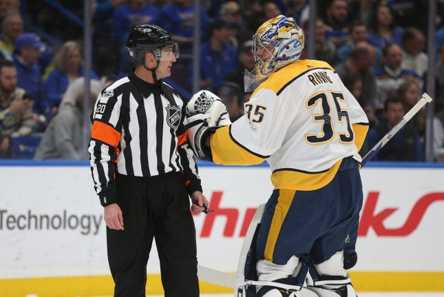 The NHL banned referee Tim Peel (L) for saying he wanted to give the Nashville Predators a penalty in their win over the Detroit Red Wings on Tuesday. File Photo by Bill Greenblatt/UPI