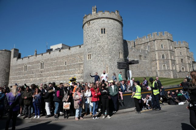 Members of the public congregate outside Windsor Castle on the day of the funeral of Prince Philip, duke of Edinburgh, and husband of Queen Elizabeth II, who was laid to rest Saturday. Photo by Hugo Philpott/UPI