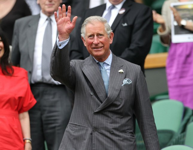 His Royal Highness Prince Charles waves to spectators from the Royal box on the third day of the 2012 Wimbledon championships in London, June 27, 2012. UPI/Hugo Philpott