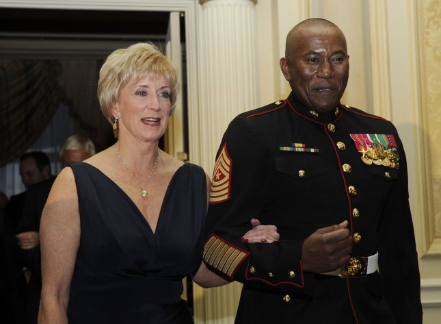 Former CEO of World Wrestling Entertainment (WWE) Linda McMahon (L) arrives at the USO Annual Awards dinner in Arlington, Virginia on March 25, 2009. (UPI File Photo/Alexis C. Glenn)