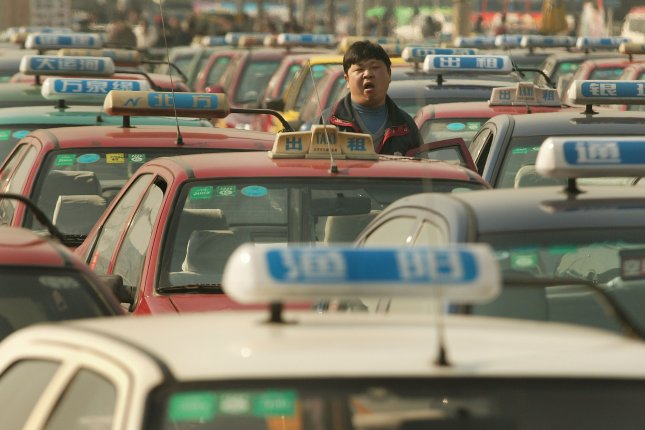 Taxis at a Beijing train station. (UPI Photo/Stephen Shaver)