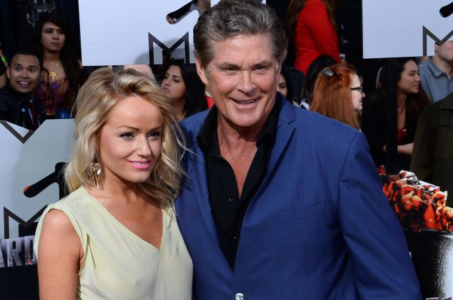 Model Hayley Roberts (L) and actor David Hasselhoff arrive for The MTV Movie Awards on April 13, 2014. The couple are engaged. File Photo by Jim Ruymen/UPI