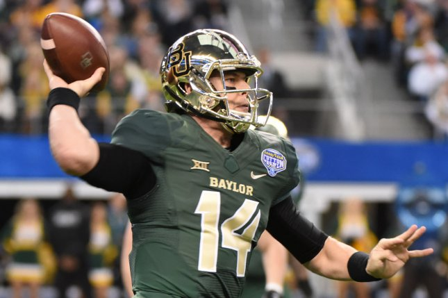Former Baylor Bear QB Bryce Petty thows against Michigan State during the first half of the Goodyear Cotton Bowl Classic in AT&T Stadium, Arlington, Texas on January 1, 2015. Ian Halperin/UPI