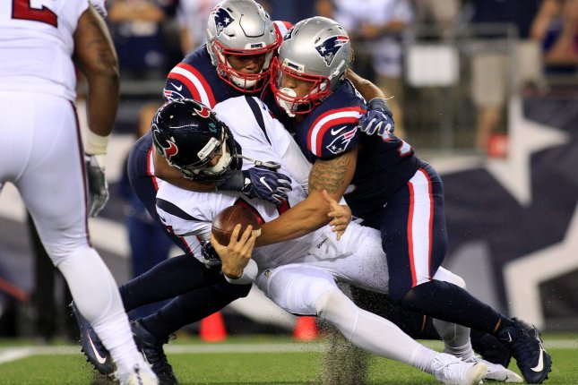 Houston Texans quarterback Brock Osweiler (17) is sacked by New England Patriots defensive lineman Jabaal Sheard (93) and Trey Flowers (98) in the fourth quarter at Gillette Stadium in Foxborough, Massachusetts on September 22, 2016. The Patriots defeated the Texans 27-0. Photo by Matthew Healey/ UPI