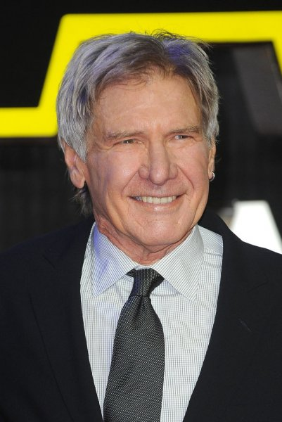 """Harrison Ford attends the European premiere of """"Star Wars: The Force Awakens"""" in London on December 16, 2015. He will return to the big screen as Indiana Jones in an untitled movie on July 10, 2020. File Photo by Paul Treadway/UPI"""