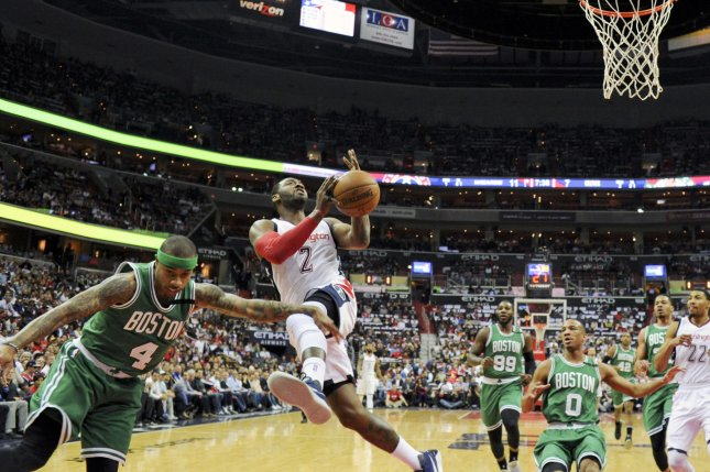 Washington Wizards guard John Wall (2) is fouled by Boston Celtics guard Isaiah Thomas (4) going to the basket in the second half at the Verizon Center in Washington, D.C. on May 4, 2017 in the NBA Conference Semifinals. The Washington Wizards defeated the Boston Celtics, 116-89. Photo by Mark Goldman/UPI