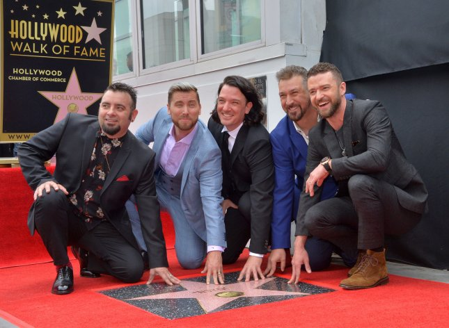 From left, Chris Kirkpatrick, Lance Bass, JC Chasez, Joey Fatone and Justin Timberlake, members of the iconic 90's boyband 'NSYNC, received a star on the Hollywood Walk of Fame on Monday. Photo by Jim Ruymen/UPI