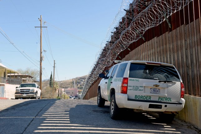 A U.S. Customs and Border Protection vehicle drives along a stretch of fence along the U.S.-Mexico border in Nogales, Ariz., on February 8. File Photo by Art Foxall/UPI