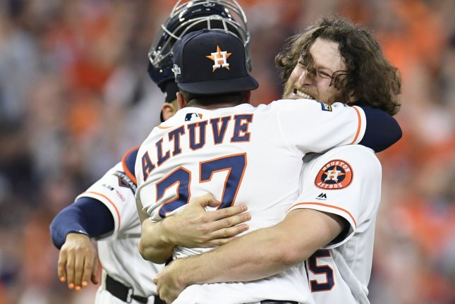 Houston Astros starting pitcher Gerrit Cole (R) hugs teammate Jose Altuve after beating the Tampa Bay Rays in the ALDS on Thursday at Minute Maid Park in Houston. Photo by Trask Smith/UPI
