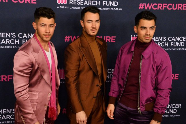 Nick Jonas, Kevin Jonas and Joe Jonas, from left to right, performed songs by Creed, Olivia Rodrigo and Harry Styles during a game on The Tonight Show starring Jimmy Fallon. File Photo by Jim Ruymen/UPI