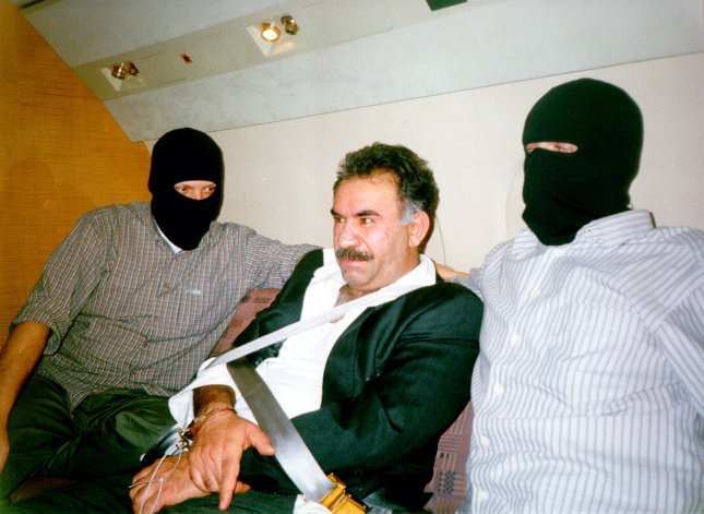 WAP99062999 - 29 JUNE 1999 - - ANKARA, TURKEY: PKK leader Abdullah Ocalan, seen here in a February 17 photo aboard a jet on his way to Turkey was sentenced to death today by a Turkish court. Ocalan was arrested at the Greek Embassy in Kenya and is blamed for a decades-old Kurdish rebel movement that is alleged to have killed thousands in Turkey. iw/ho/ UPI