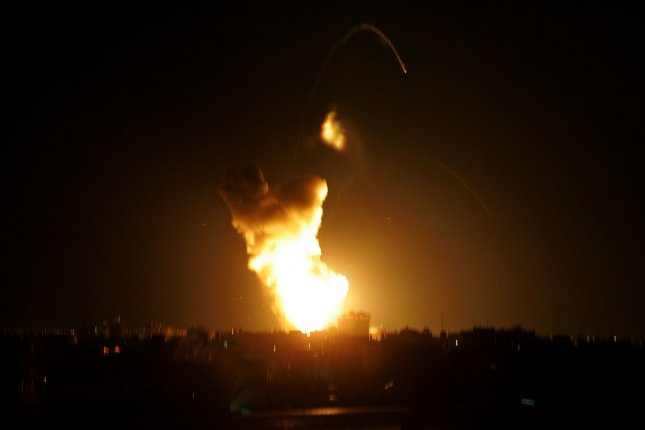 An explosion is seen following an Israel air strike in Rafah near the Gaza Strip's border with Egypt on March 19, 2010. An Israeli warplanes fired rockets on a number of targets in Gaza, witnesses said. UPI/Ismael Mohamad
