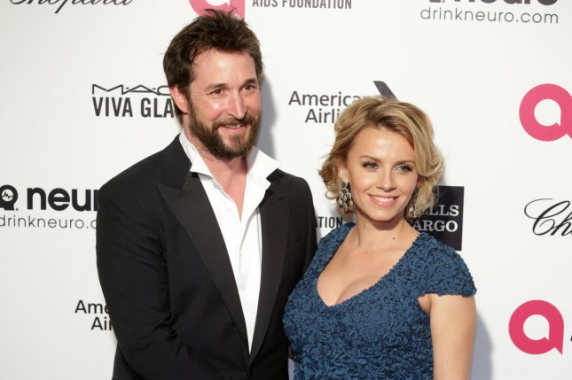 Noah Wyle (L) and wife Sara Wells at the Elton John AIDS Foundation Academy Awards viewing party on February 22, 2015. File photo by Jonathan Alcorn/UPI