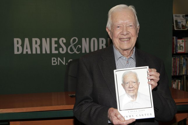 Former United States President Jimmy Carter arrives to sign copies of his book A Full Life at Barnes & Noble Fifth Avenue in New York City on July 7, 2015. James Earl Jimmy Carter, Jr. is an American politician, author, and member of the Democratic Party who served as the 39th President of the United States from 1977 to 1981. Doctors said Carter, who was undergoing treatment for skin cancer, can stop treatments after positive MRI results. Photo by John Angelillo/UPI