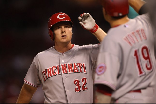 Cincinnati Reds' Jay Bruce is greeted by teammate Joey Votto. UPI/Bill Greenblatt