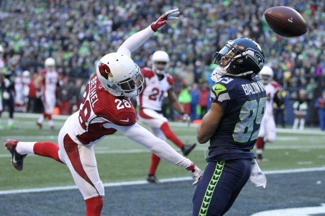 Arizona Cardinals cornerback Justin Bethel (28) breaks up a pass intended for Seattle Seahawks wide receiver Doug Baldwin (89) in the end zone on December 24, 2016 at CenturyLink Field in Seattle, Washington. File photo by Jim Bryant/UPI