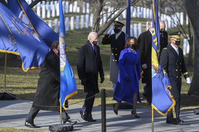 President Joe Biden and Vice President Kamala Harris arrive for a wreath-laying ceremony Wednesday at the Tomb of the Unknown Soldier in Arlington National Cemetery in Virginia. Pool Photo by Katherine Frey/UPI