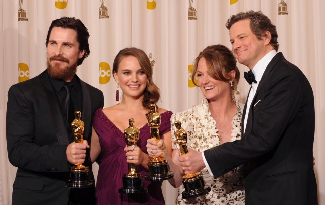 Left to right, Best Supporting Actor Christian Bale, Best Actress Natalie Portman, Best Supporting Actress Melissa Leo and Best Actor Colin Firth pose backstage at the 83rd annual Academy Awards in Hollywood on February 27, 2011. UPI/Jim Ruymen