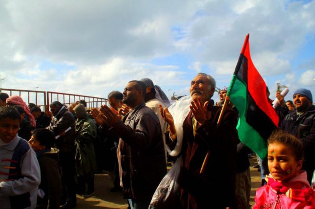 Libyans pray during a demonstration in the dissident-held city of Benghazi Feb. 26, 2011. UPI\Mohamad Shaikhi
