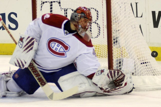 Montreal Canadiens goalie Jaroslav Halak blocks a shot with his pads in the second period of the Candadiens 5-2 win over the Pittsburgh Penguins in game seven of the NHL Eastern Conference Semi Finals at Mellon Arena in Pittsburgh on May 12, 2010. UPI/Archie Carpenter