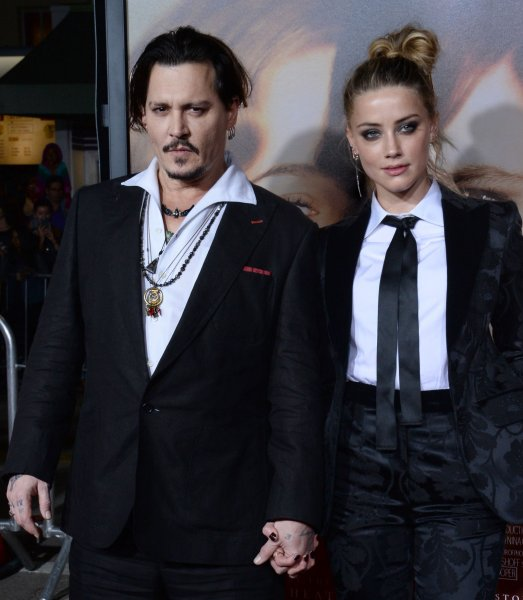 Amber Heard and her husband Johnny Depp attending the premiere of the The Danish Girl on Nov. 21. During the premiere, Depp spoke highly of his wife saying I'm a lucky man. Photo by Jim Ruymen/UPI