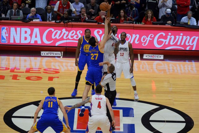 Los Angeles Clippers center DeAndre Jordan (6) out jumps Golden State Warriors center Zaza Pachulia (27) at Staples Center in Los Angeles, December 7, 2016. Photo by Jon SooHoo/UPI