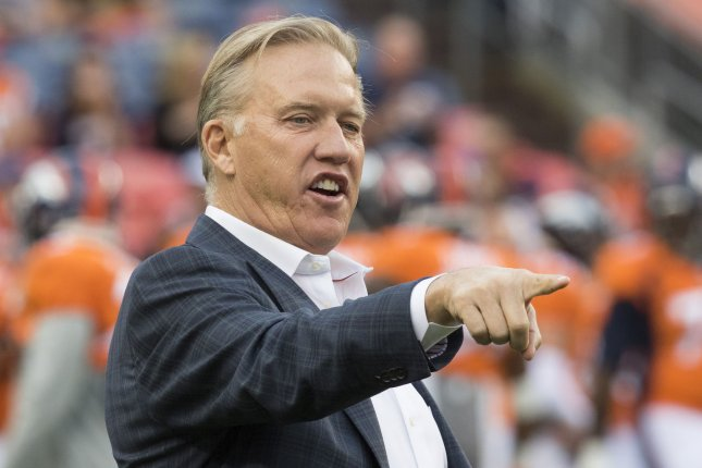 Denver Broncos executive Vice-President and General Manager John Elway, who may have to find replacements for head coach Gary Kubiak and defensive coordinator Wade Phillips, gestures during pre-season game three at Sports Authority Field at Mile High in Denver on August 27, 2016. News reports indicated that Broncos head coach Gary Kubiak may step down after the final regular season game against the Oakland Raiders due to health concerns. File Photo by Gary C. Caskey/UPI