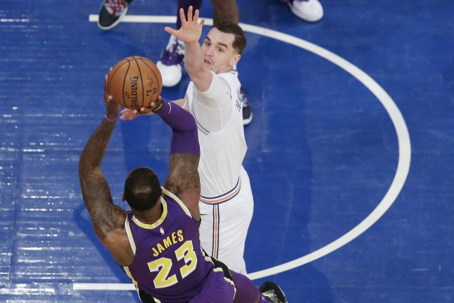 2986c0333ae3 New York Knicks forward Mario Hezonja tries to block a shot from Los  Angeles Lakers star LeBron James (23) in the first half on Sunday at Madison  Square ...