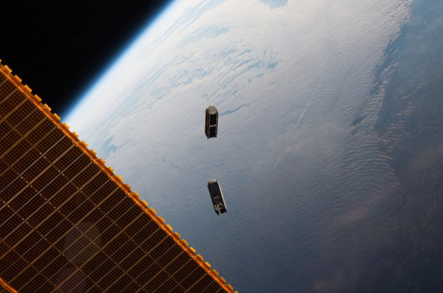 Earth-imaging satellites, like these being launched in 2016 by Planet Labs, are increasingly used to combat climate change. Photo courtesy of NASA