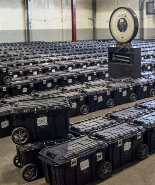 Cases of ballots wait to be counted at a warehouse in Pittsburgh, Pa., on Election Day, November 3. Photo by Archie Carpenter/UPI