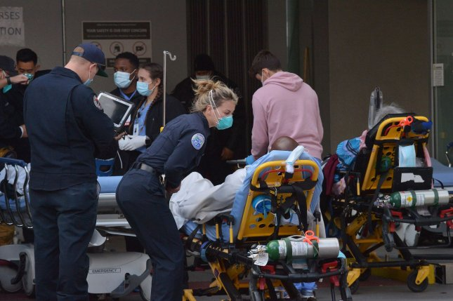 Emergency personnel transport patients Wednesday at Martin Luther King Hospital in Los Angeles. The population served by the hospital is largely Latino and Black communities that have been severely affected by the pandemic. Photo by Jim Ruymen/UPI