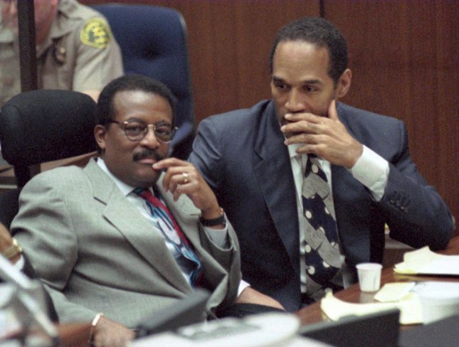 O.J. Simpson and his lawyer, Johnnie Cochran, listen as Brian Kato Kaelin, the live-in guest at Simpson's Rockinham mansion the night that Nicole Brown Simpson and Ronald Goldman were murdered, testifies on March 21, 1995, in the Double-Murder Trial of the former football star. File Photo by John McCoy/Pool/UPI