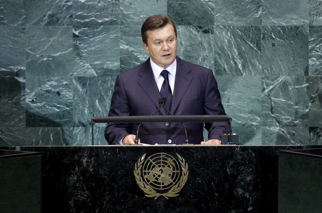 The Obama administration is imposing additional sanctions against Russian entities and individuals within the inner circle of ousted Ukrainian President Viktor Yanukovych. Yanukovych is seen speaking at at the 65th United Nations General Assembly in New York City in 2010. File Photo by John Angelillo/UPI