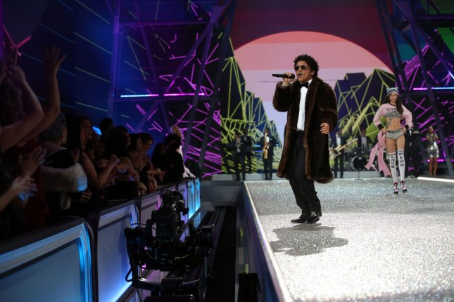 A model takes to the catwalk as American singer Bruno Mars performs during the Victoria's Secret's show at the Grand Palais in Paris on November 30, 2016. Mars has won the 2017 iHeartRadio Innovator Award. File Photo by Maya Vidon-White/UPI