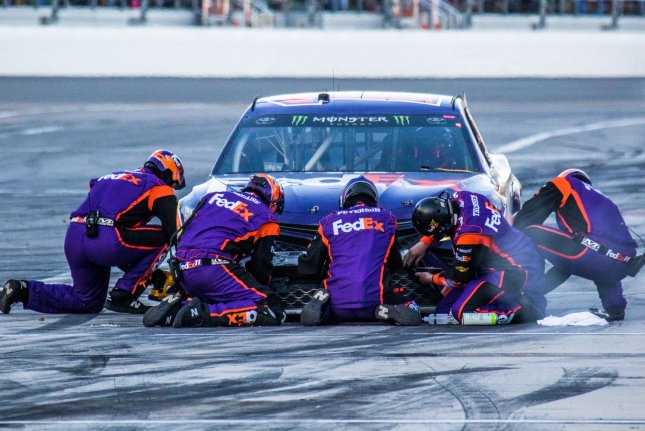Denny Hamlin's crew works on his car during a pit stop at the Daytona 500 in Februar. Photo by Edwin Locke/UPI