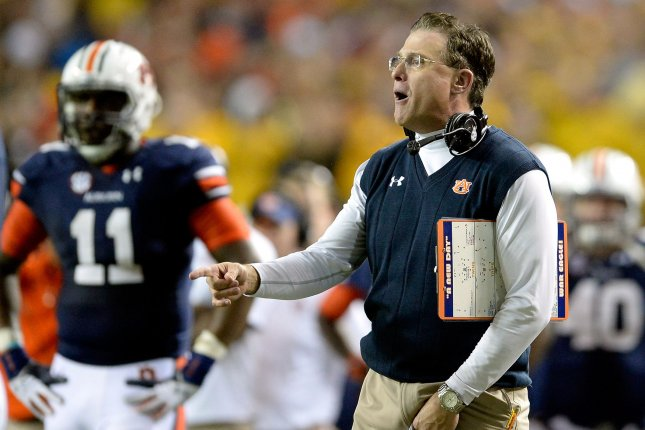 Auburn head coach Gus Malzahn shouts to a referee during the second half of the SEC Championship football game against Missouri at the Georgia Dome in Atlanta on December 7, 2013. File photo by David Tulis/UPI