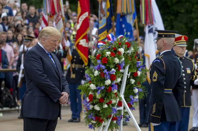 President Donald Trump bows his head at a wreath-laying ceremony at the Tomb of the Unknown Solider at Arlington National Cemetery on Memorial Day on Monday. Photo by Tasos Katopodis/UPI