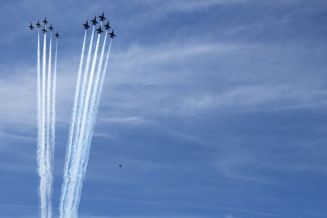 The Navy's Blue Angels and U.S. Air Force Thunderbirds fly over the Lincoln Memorial on the National Mall in Washington, D.C., on Saturday. Photo by Pat Benic/UPI