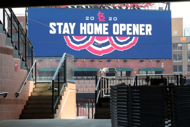 The scoreboard welcomes an empty Busch Stadium on what should be Opening Day of the 2020 season in St. Louis on Thursday, April 2, 2020. Data from the U.S. Centers for Disease Control and Prevention from 1962 to 2016 indicate that flu deaths increased 5 percent to 24 percent during the NFL, NBA, NHL and MLB seasons. Photo by Bill Greenblatt/UPI