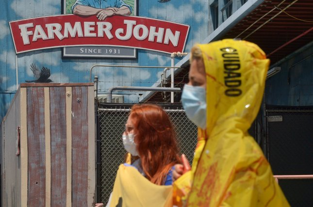 A small group of activists stage a protest outside a slaughterhouse in Vernon, Calif., on May 21 amid outbreaks of COVID-19 at industrial facilities. File Photo by Jim Ruymen/UPI